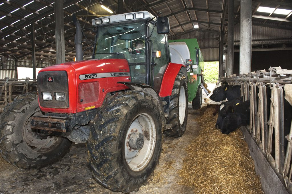 Feeding cattle with diet feeder. Photo O'Gorman Photography.