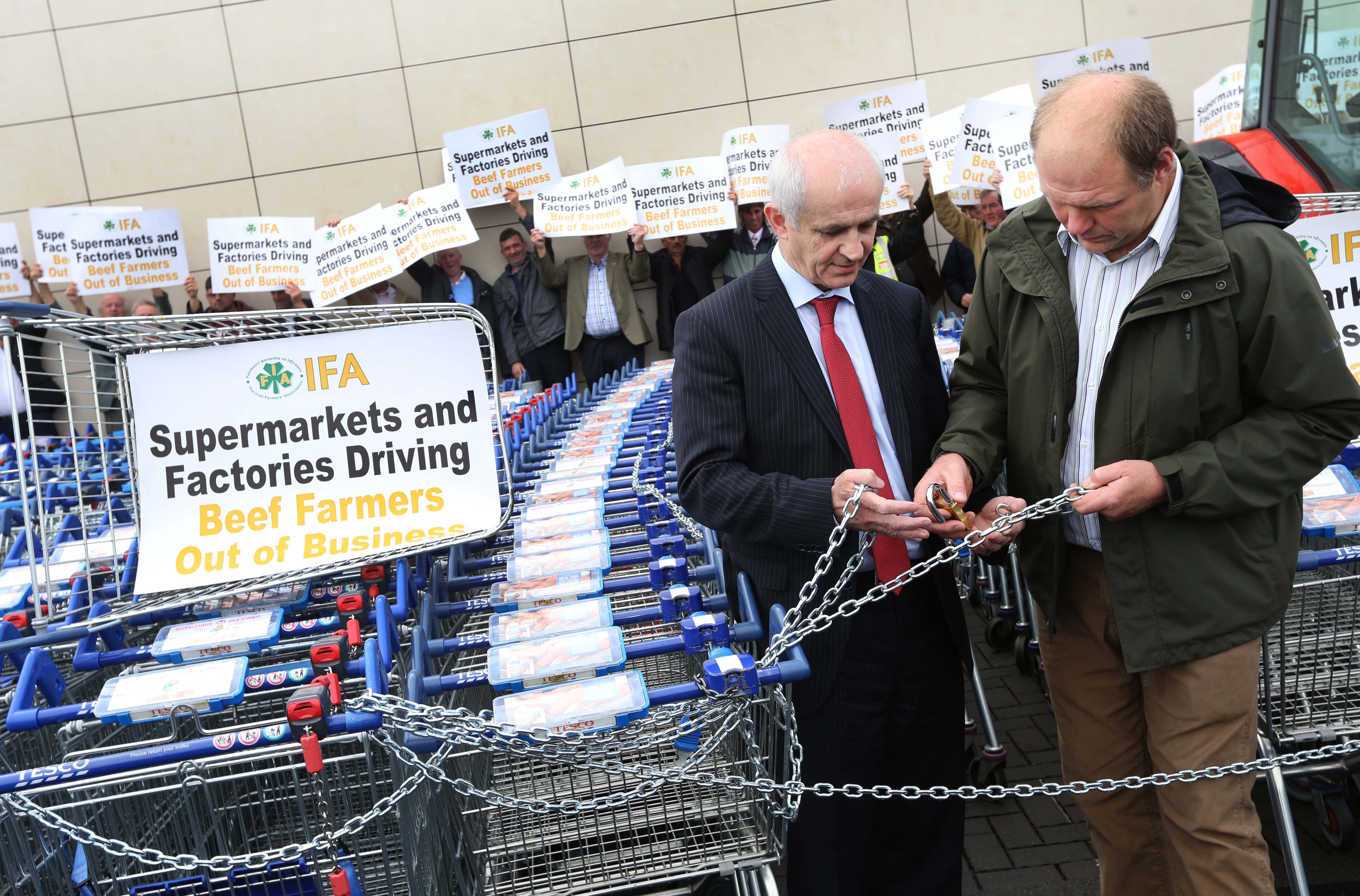 IFA President Eddie Downey and IFA National Livestock chairman Henry Burns lock some trollies. Over 500 IFA members protested at Tesco in Naas Co Kildare.