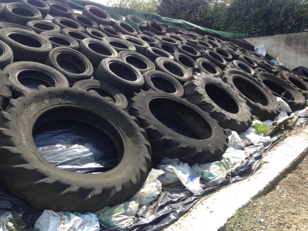 Silage pit covered tyres