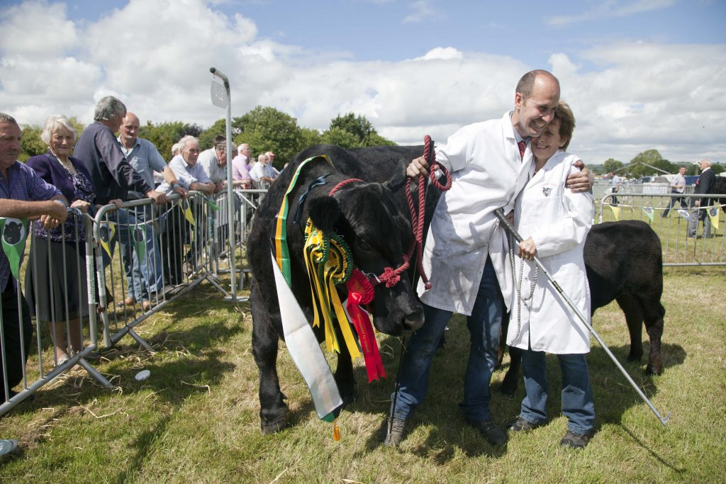 Over All Champion Aberdeen Angus  Lady Melton with her owners Estace and Deirdre Burker of Carrigaline Co. Cork.