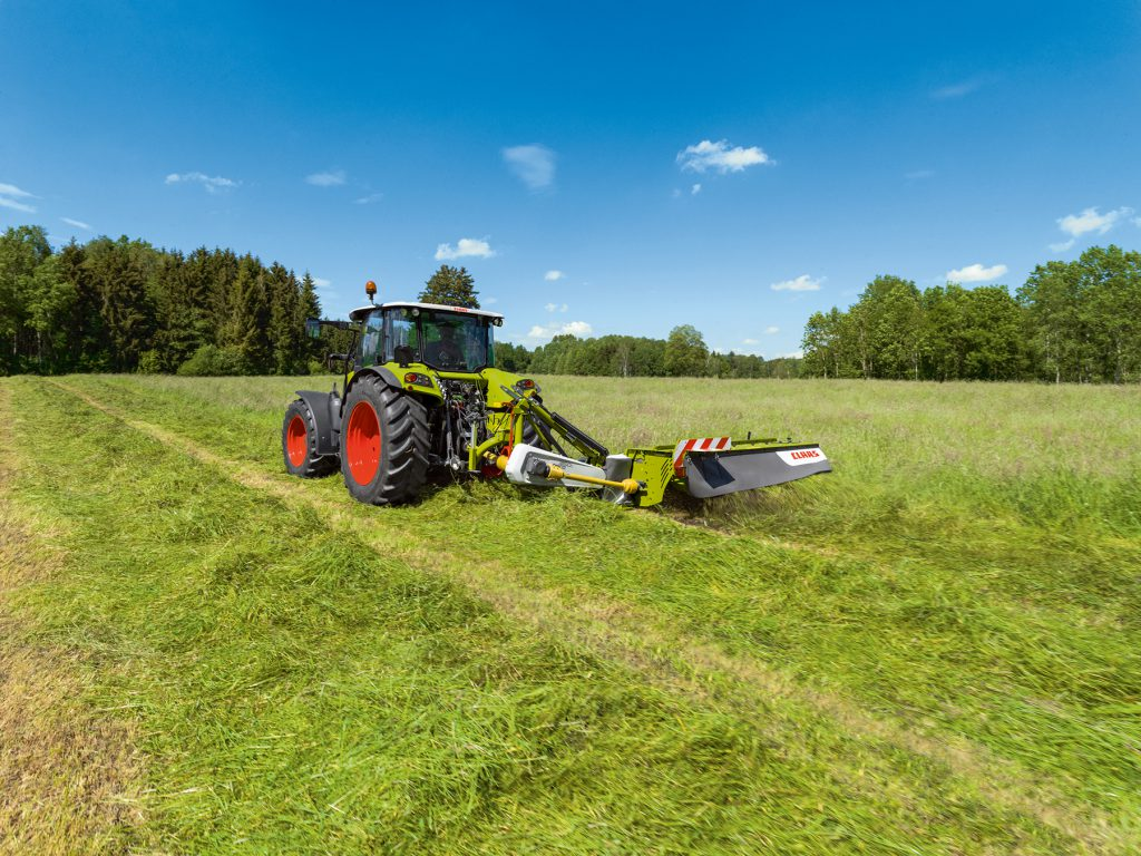 Claas Disco mower in operation.
