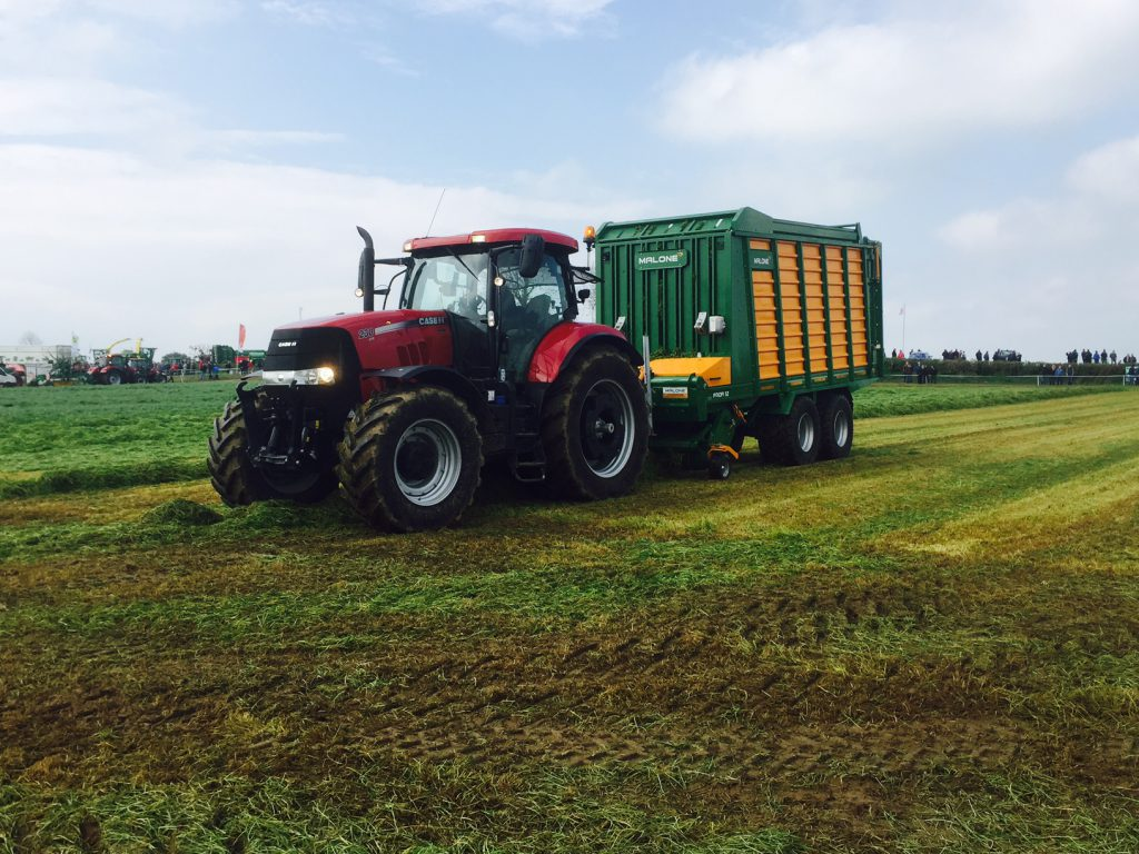 Case IH CVX 230 and Malone Profi 52 silage wagon