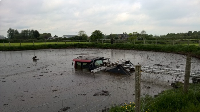Farmer has lucky escape after tractor becomes submerged in slurry pit