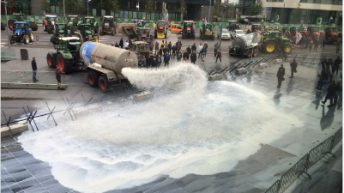 Tankers spray 40,000L of milk over EU buildings in Luxembourg in protest