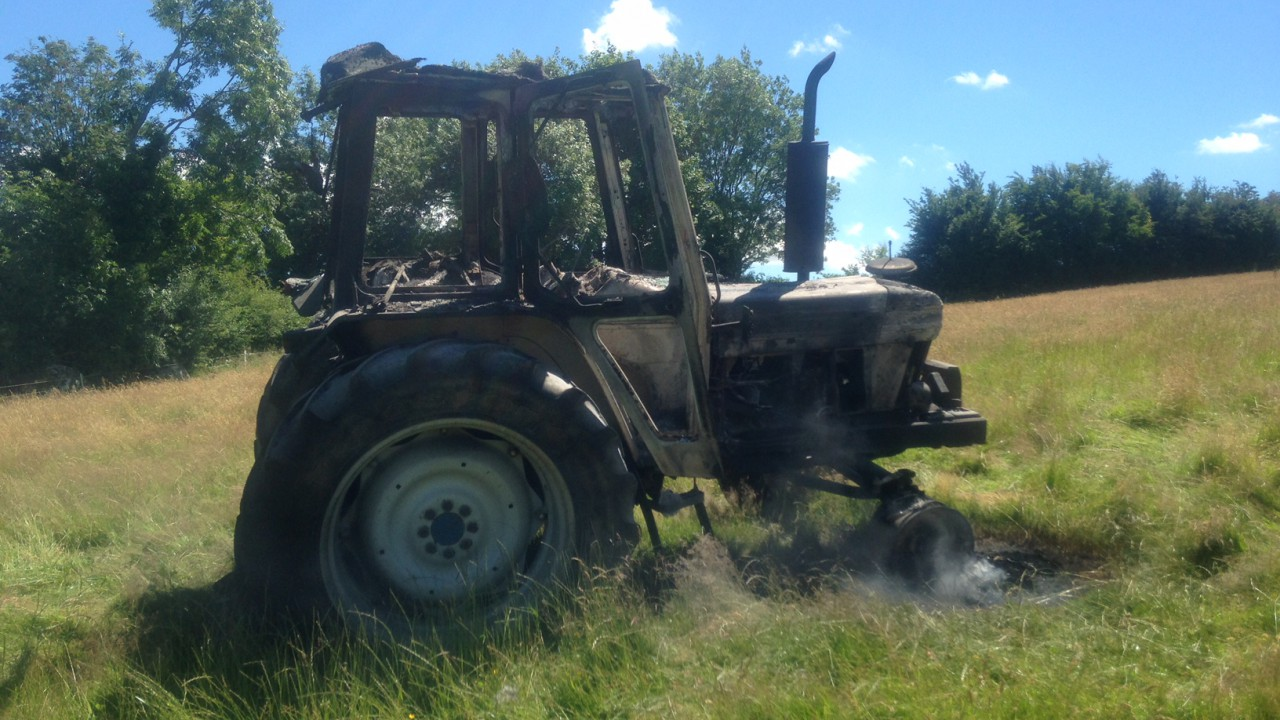 Contractor has lucky escape as tractor goes on fire in hay field