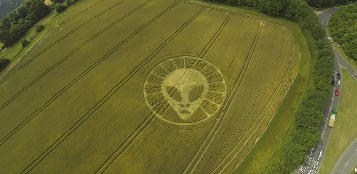 Crop circle of an alien appears in a field of wheat in the UK