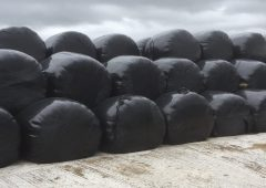 How high should I stack my round-baled silage?