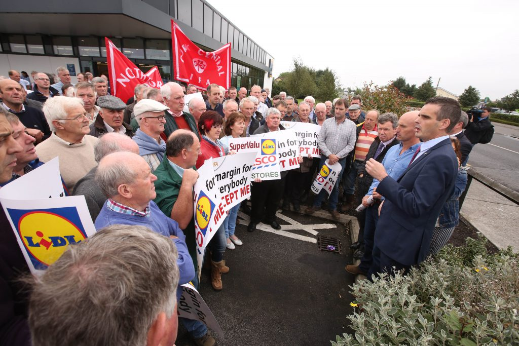 IFA President Joe Healy and IFA Livestock Chairman Angus Woods lead livestock farmers, angry at excessive and unjustified beef price cuts, as they staged a protest at the Aldi supermarket in Tullamore today. Picture: Finbarr O'Rourke