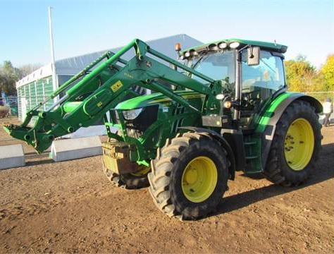 A John Deere 6125R with a front loader sold for