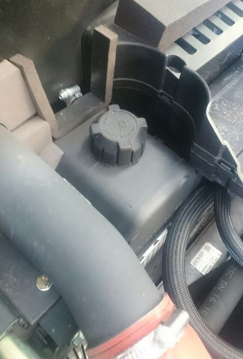 Take care opening any radiator or header tank cap due to high temperatures