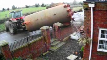 Video: Dramatic footage of slurry tank crashing through a garden wall