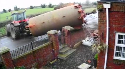 Video: Dramatic footage of slurry tank crashing through a garden wall