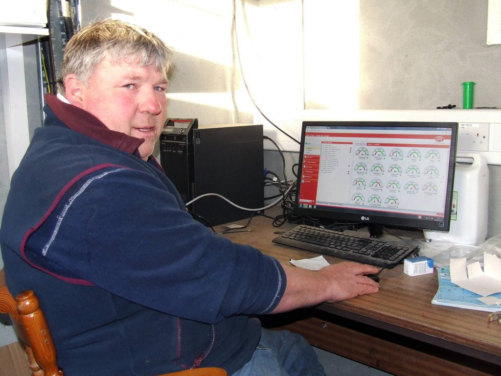 Denis Condron monitoring cow performance on his farm in Co. Offaly