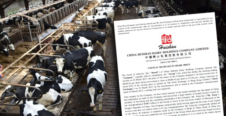 Regulators put Chinese dairy titan's shares on lockdown