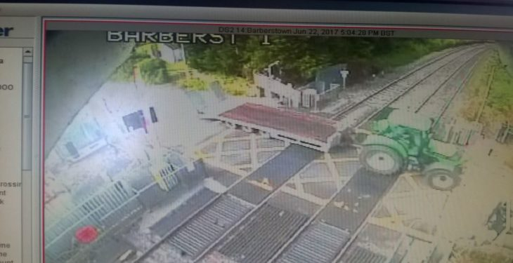Train services disrupted as tractor destroys level crossing