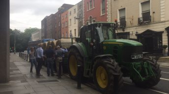 Video: Bales of straw arrive at department HQ as IFA protest gathers pace