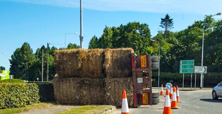 Pic: Trailer load of straw overturns at roundabout in Wexford