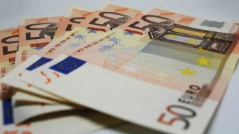 How does the Irish 'cheque in the post' compare to Europe?