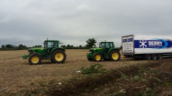Pics: Tractors retrieve stranded articulated lorry from a field