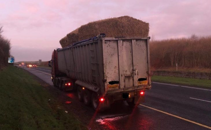 Pics: Lucky escape for motorists as bales fall from lorry on motorway