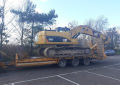 Pic: Tractor hauling excavator stopped for using 'green' diesel and being overweight