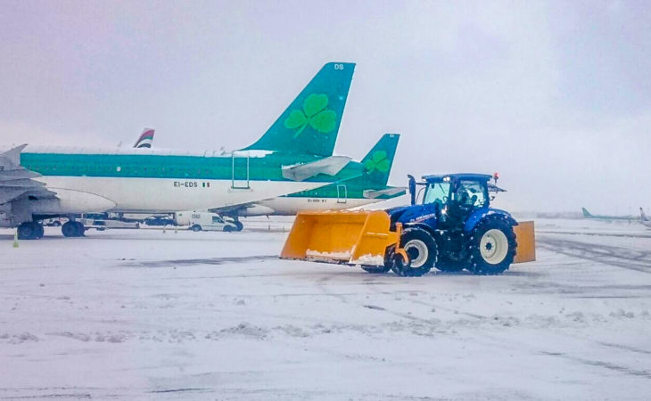 41 New Holland tractors battle today's snow…at Dublin Airport