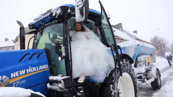 Watch: Storm and snow prove no obstacle to these newly-weds