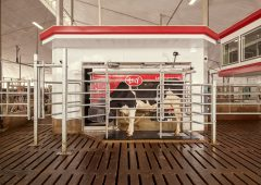 What does Lely's fully robotic dairy farm vision entail?