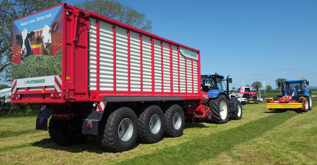 Grass & Muck: 3-axle monster flies flag for wagon fanatics