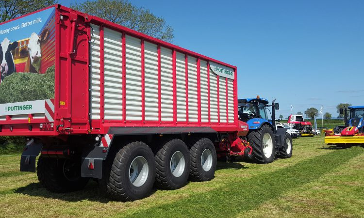 Grass & Muck: 3-axle monster flies flag for wagon fanatics