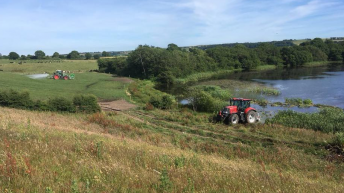 Spreading 25,000 gallons of water per acre to boost grass growth