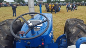 The road to 'Tipp': 99 County tractors cluster together in one field