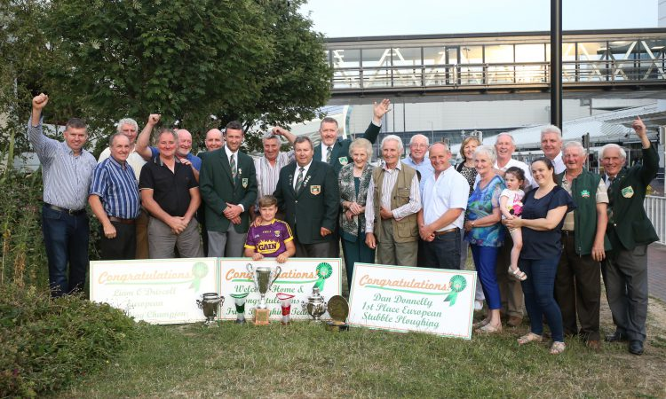 Ploughing team hailed as heroes on return from Russia