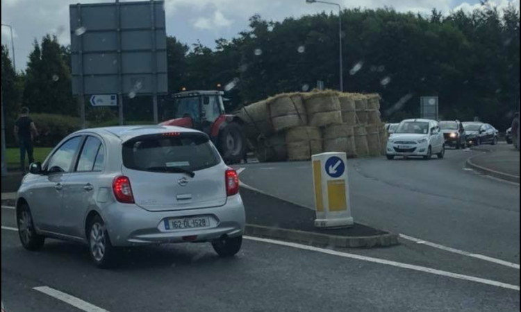 Trailer of bales overturns in Donegal