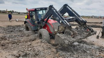 Tractor stuck on UK beach for 2 days pulled free
