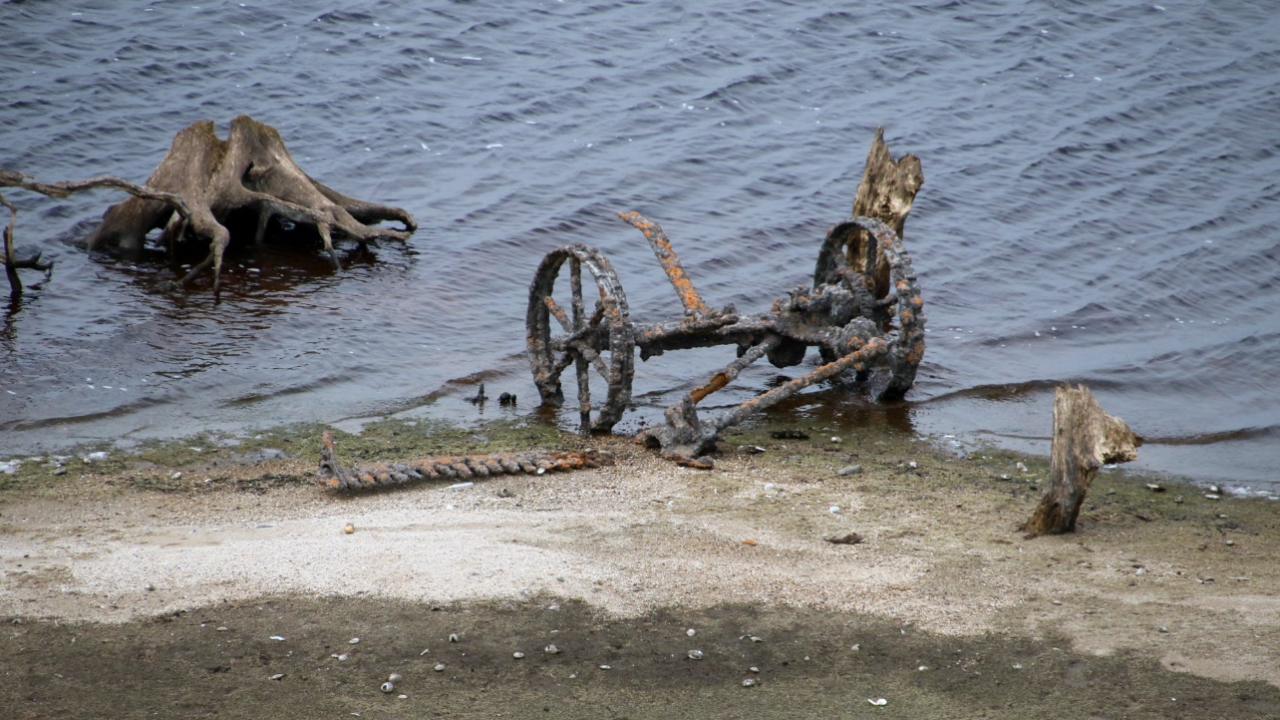 Ruins of homestead and farm machinery in lake uncovered