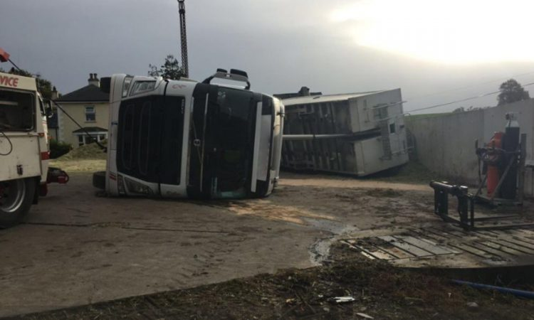Pics: Telehandler crushed when articulated lorry overturns