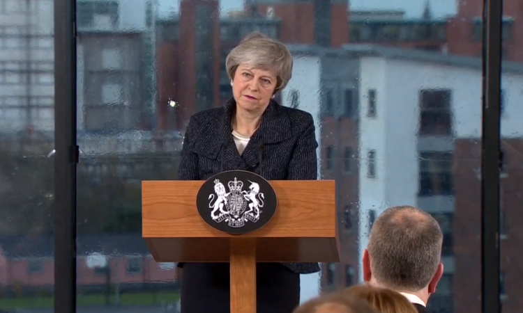 May reassures 'full protection for cross-border cooperation'