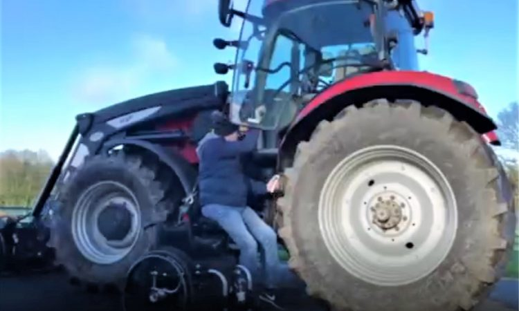 Tractor hoist gets paralysed farmer back in the driving seat