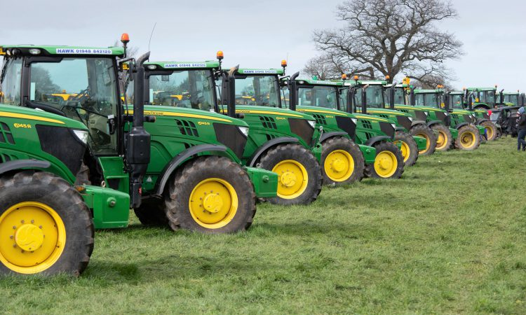 Auction report: Sample 6R/M Series tractor prices from giant sale
