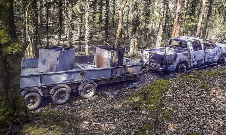 Bank robbery getaway vehicle discovered burned out in wood