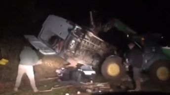 Farmer overturns van 'dumping rubbish' on his land