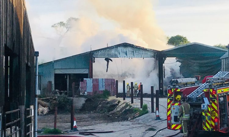 Firefighters tackle blaze affecting 6 barns on UK holding