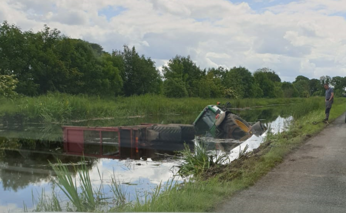 Tractor and silage trailer slides into Royal Canal