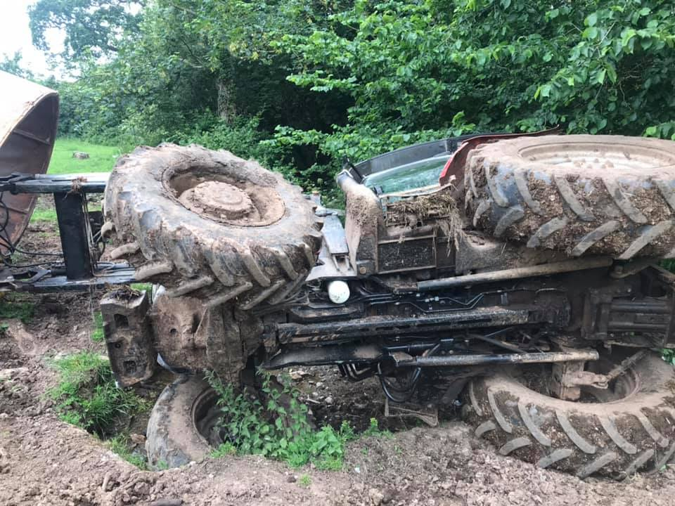 overturned tractor rescued farmer firefighters
