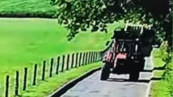 Video: Bale trailer breaks loose from towing tractor