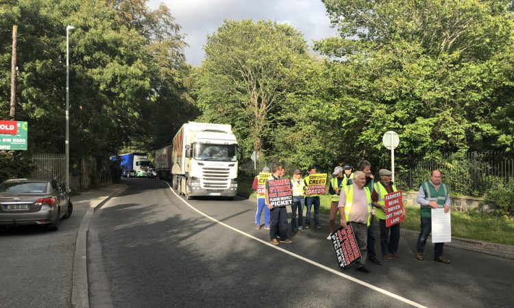 Protesters delay lorries leaving Tesco Distribution Centre in Ballymun