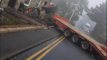 Tractor and low-loader involved in collision with house