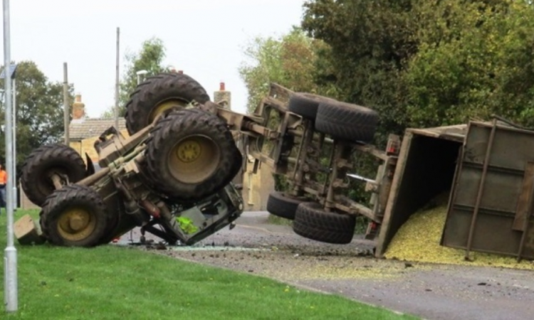 Lucky escape as tractor drawing maize flips onto roof