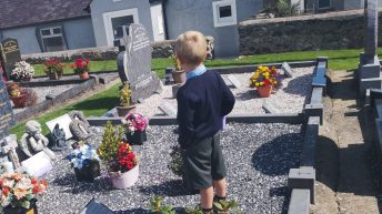 Telling daddy all about the first day at school – at his graveside